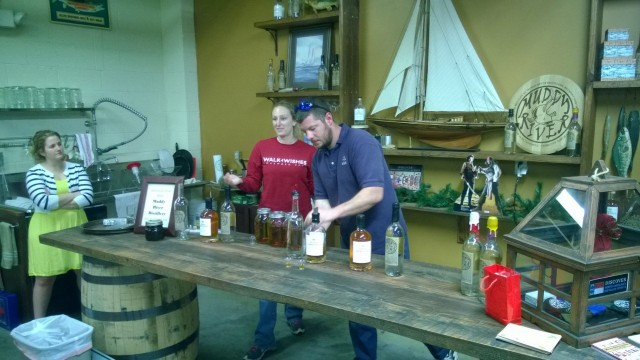 Robbie and Caroline pouring our rum. . . .